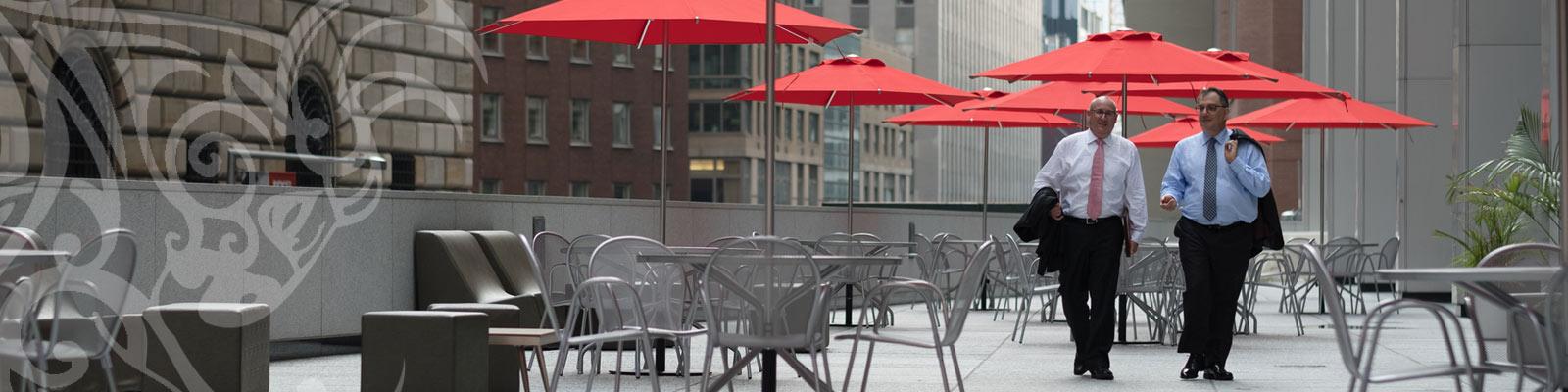 About-the-Firm-Wasser-Russ-NY-Attorneys Walking under umbrellas