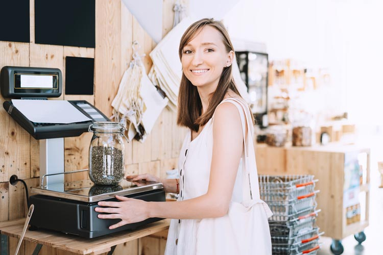 Woman-weighing-cannabis-as a career